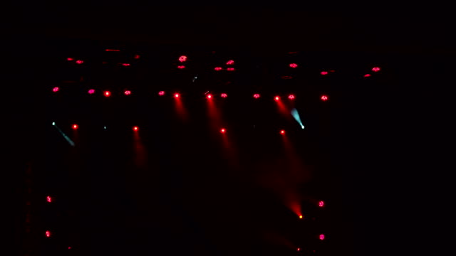 Red-stage-lights-light-show-at-the-concert-