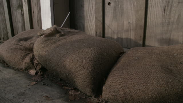 Close-Up-Flood-Protection-Sandbags-dolly-shot-4K-UHD-