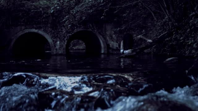 4K-Horror-Woman-Hiding-Scared-in-River