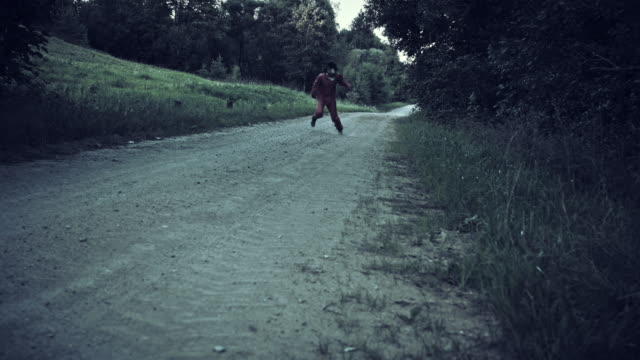 4K-Halloween-Horror-Man-with-Pig-Mask-Running-Crazy