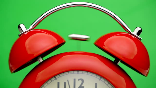 Red-alarm-clock-Green-screen-Close-up-view-