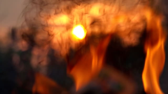 Slow-motion-flame-fire-Burning-flame-of-fire-close-up-on-sun-background
