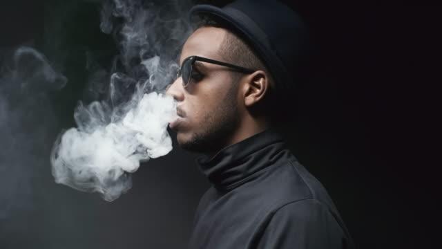 Cool-Black-Man-in-Sunglasses-Exhaling-Smoke