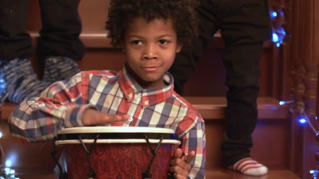 Enthusiastic-darkskinned-boy-playing-drum-