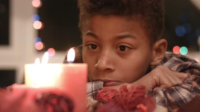 Sad-boy-looking-at-candle-