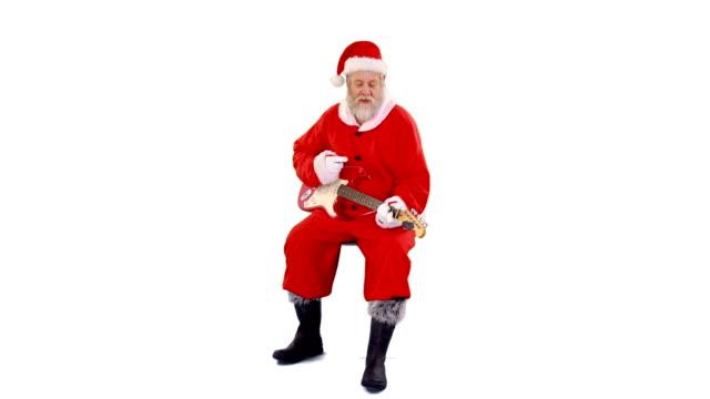 Santa-claus-singing-a-song-and-playing-guitar