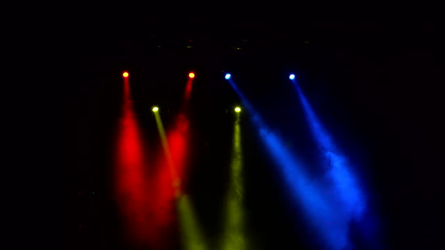 Red-blue-and-yellow-searchlights-on-stage-