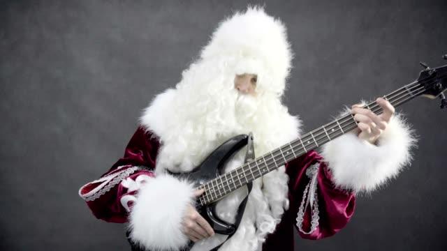Juegos-de-santa-claus-de-la-melodía-de-Navidad-jingle-bells-en-la-guitarra-baja