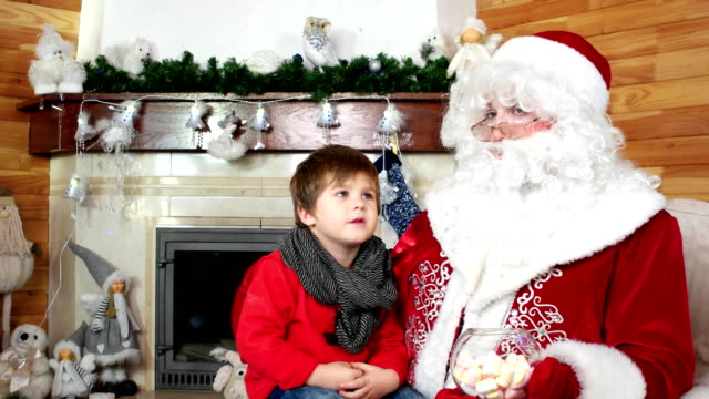 little-kid-telling-santa-his-christmas-wishes-room-with-fireplace-boy-visit-santa-claus-residence