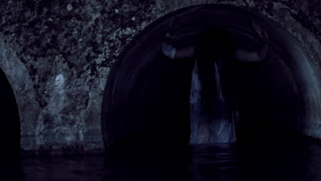 4K-Horror-Woman-Walking-out-from-Water-Pipe