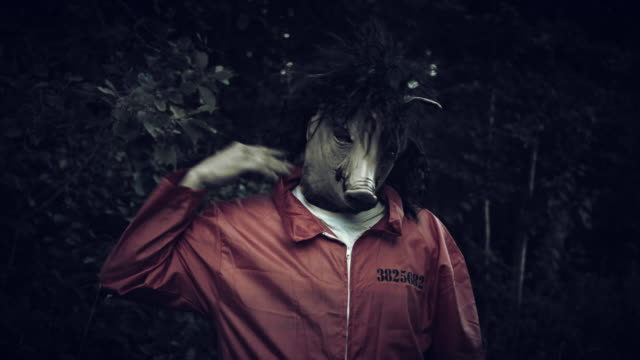 4K-Halloween-Horror-Man-with-Pig-Mask-Evil-Portrait