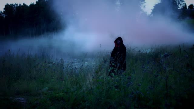 4K-Halloween-Horror-Man-with-Black-Cape-in-Smoke