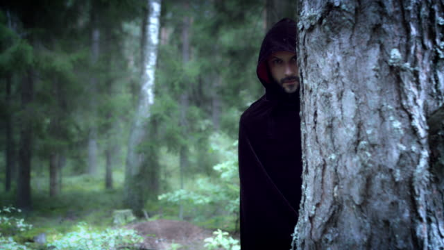 4K-Halloween-Horror-Man-Hiding-in-Woods-with-Black-Cape