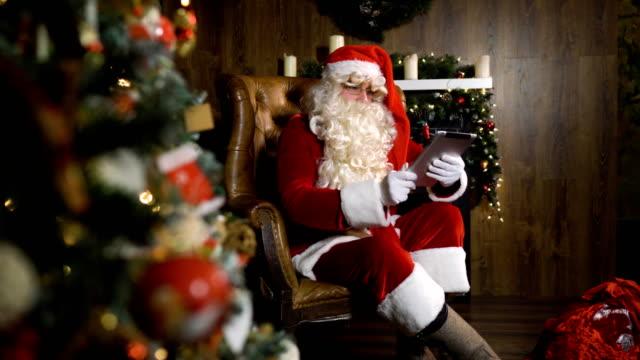 Santa-Claus-working-with-iPad