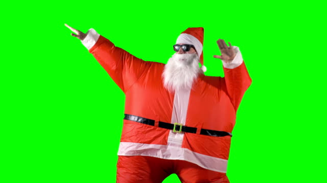 Santa-Claus-en-danzas-de-colores-sobre-un-fondo-verde-