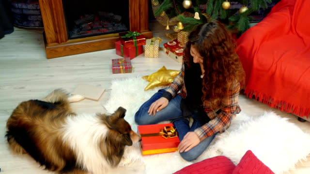 A-girl-gives-a-gift-with-cookies-to-her-dog