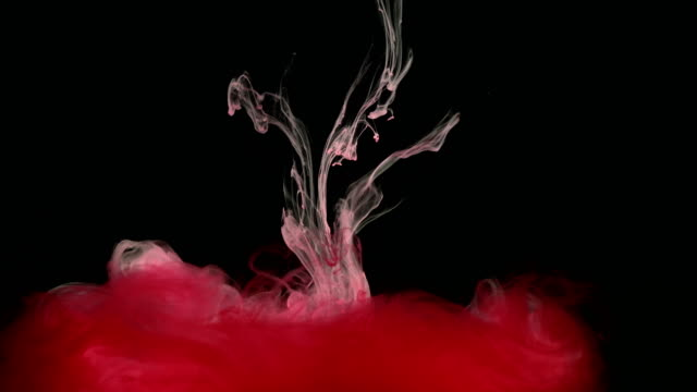 Pintura-tinta-roja-en-el-agua-creando-formas-artísticas-líquidos