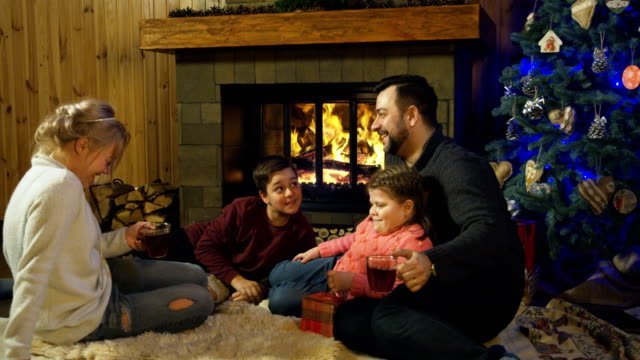 Content-family-at-fireplace-before-Christmas