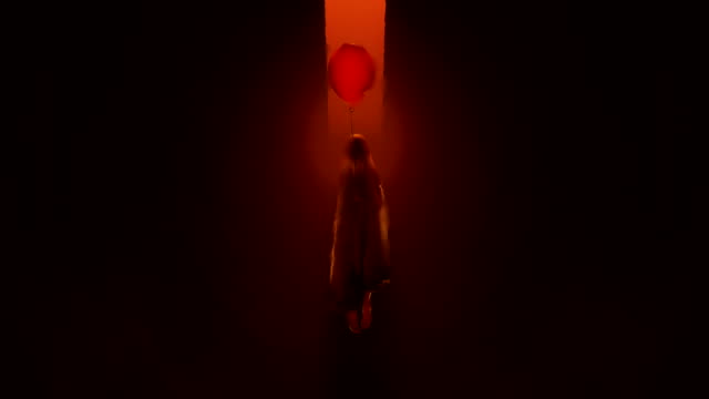Evil-Spirit-of-a-Child-with-a-Red-Balloon-floating-in-a-fiery-inferno