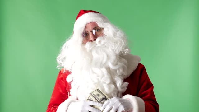 Satisfied-Santa-Claus-throwing-bills-out-of-a-bundle-money-rain-concept-green-chromakey-in-the-background
