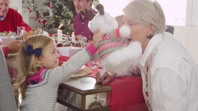Girl-With-Grandmother-Enjoying-Christmas-Meal-Shot-On-R3D
