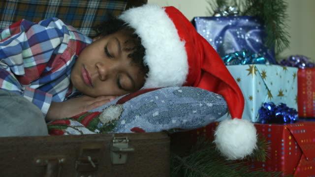 Happy-kid-sleeping-inside-suitcase-