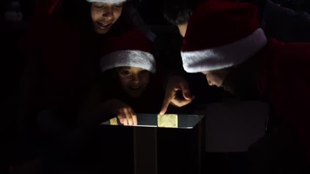 Family-Opening-a-Magic-Gift-Box