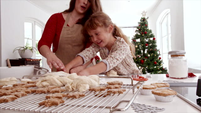 Mother-and-child-preparing-Christmas-cookies