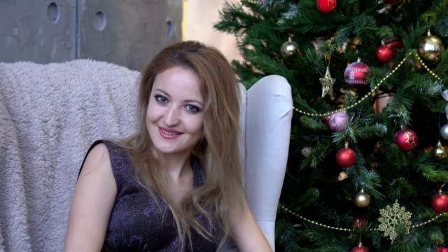 Woman-shaking-head-to-accept-yes-on-christmas-tree-background