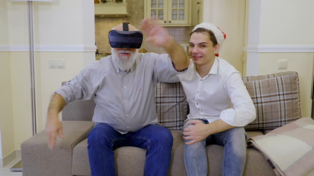 Grandfather-with-grandson-uses-virtual-reality-glasses