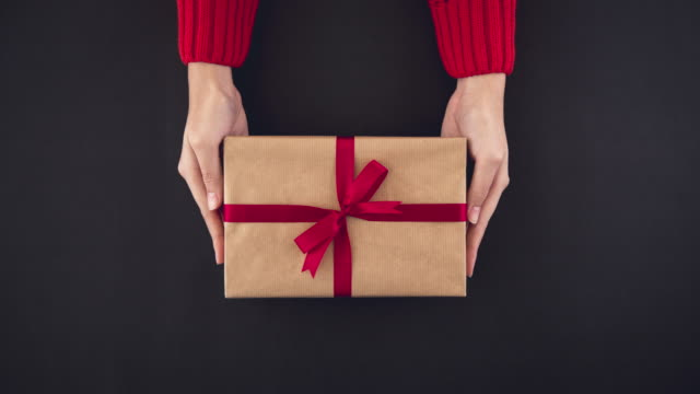 Variety-of-colorful-Christmas-gift-boxes-in-woman-hands