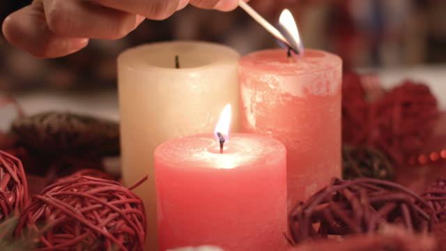 Child-s-hand-lighting-Christmas-candles-