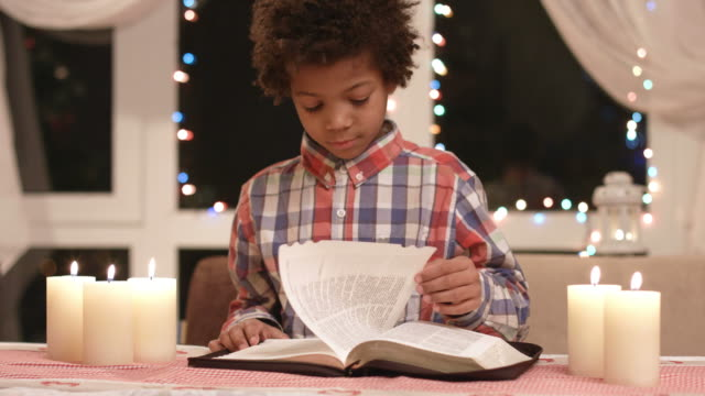 boy-turning-book-pages-