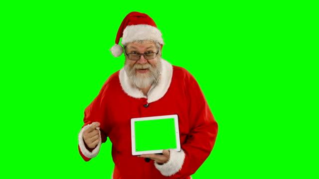 Santa-claus-holding-digital-tablet-
