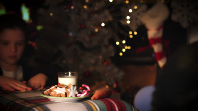 4k-Christmas-and-New-Year-Holiday-Child-Leaving-Letter-and-Cookies-for-Santa