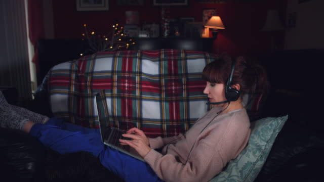 4k-Authentic-Shot-of-a-Woman-Working-with-Headphones-and-Laptop