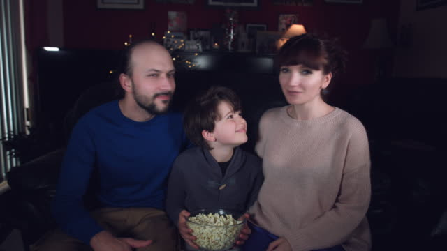 4k-Authentic-Shot-of-a-Funny-Family-Watching-Movie-with-Popcorn-and-Dancing