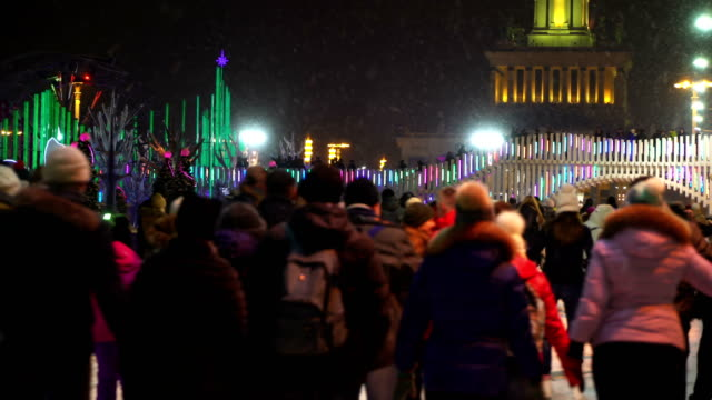 Concept-winter-sport-Crowd-at-Night-Skating-Rink-Falling-Snow-Christmas-Star