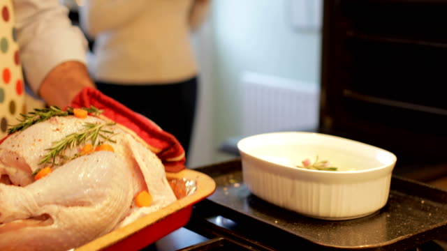 Putting-The-Turkey-In-The-Oven