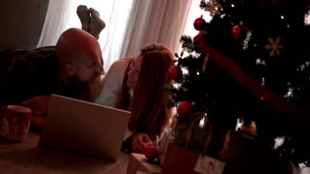 Couple-using-laptop-and-credit-card-for-online-Christmas-shopping