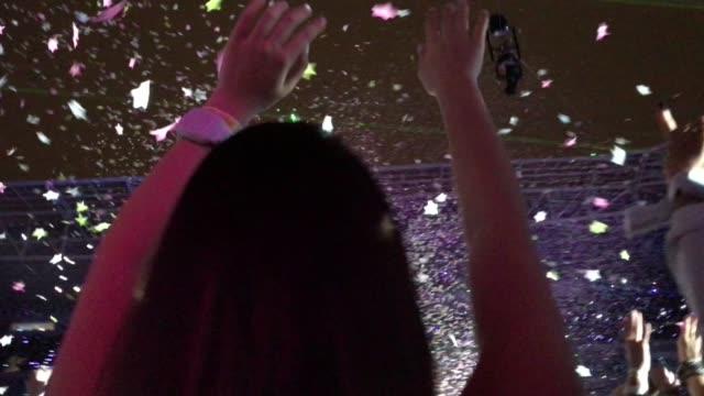 Woman-Celebration-with-Confetti-Falling