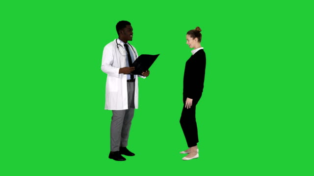 Physician-showing-a-patient-the-X-ray-results-Then-patient-leaves-on-a-Green-Screen-Chroma-Key
