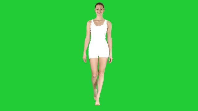 Lady-walking-in-white-sports-lingerie-and-smiling-on-a-Green-Screen-Chroma-Key