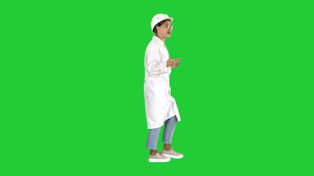 Woman-engineer-walkin-and-talking-emotionaly-on-a-Green-Screen-Chroma-Key