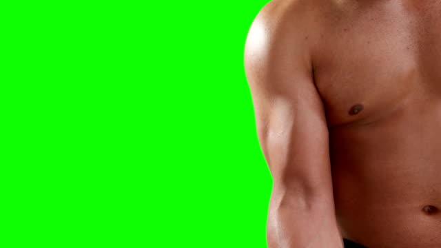 Serious-muscular-man-lifting-dumbbells