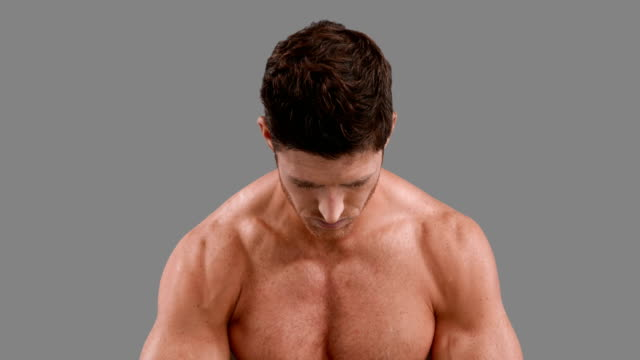 Muscular-man-flexing-his-muscles
