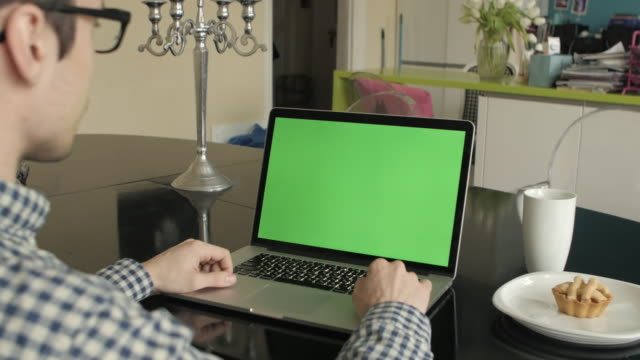 A-Man-Types-on-a-Laptop-on-His-Desk