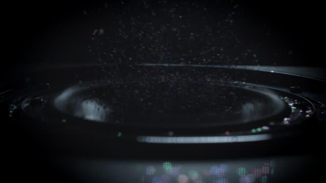 4-k-Resumen-antecedentes-de-Subwoofer-en-movimiento-rápido-con-brillo