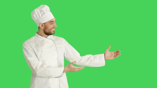 Mid-Shot-of-a-Handsome-Chef-making-Presenting-Gesture-Background-is-Green-Screen-