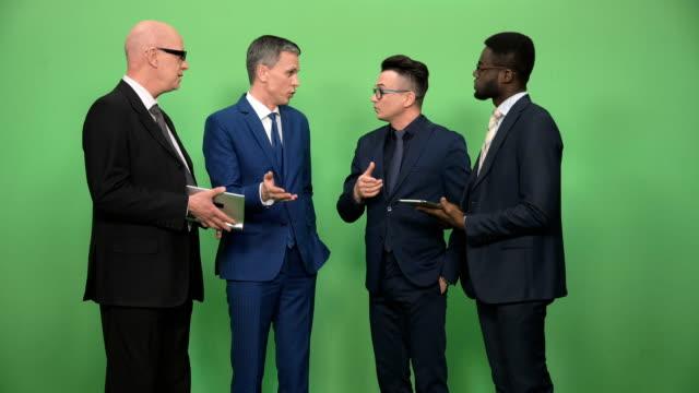 Four-businessmen-having-conversation